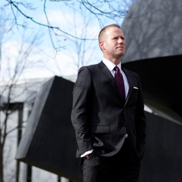Jonathan Reid owner, Jeffrey Ives, outside in a dark suit