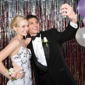 Teenagers at Prom taking a selfie picture