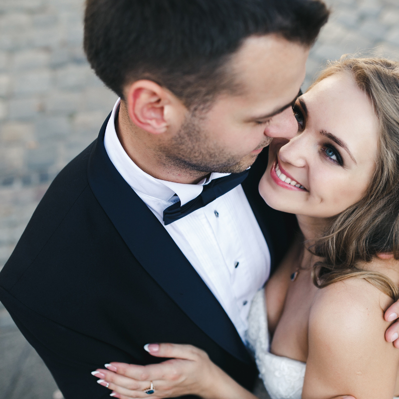 Bride and groom hugging closely